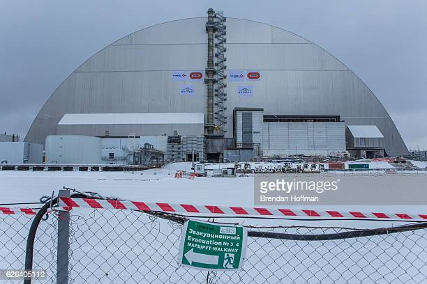The New Safe Confinement sarcophagus covers the destroyed reactor number four at the Chernobyl nuclear power station on November 29 2016 in Chernobyl...