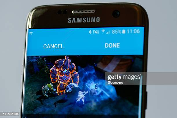 The new Samsung Electronics Co Galaxy S7 edge with 3D thermo forming which shows the new software 'Game Launcher' page in this arranged photo in...