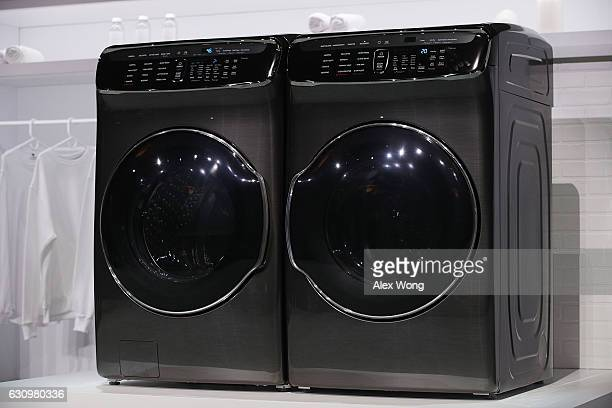 The new Samsung FlexWash and FlexDry washer and dryer are on display during a press event for CES 2017 at the Mandalay Bay Convention Center on...