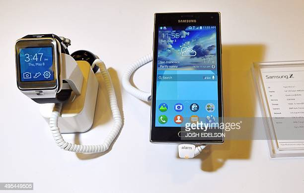 The new Samsung Z910F Smartphone and the SMR380 Smartwatch are seen on display at the Tizen Developer Conference in San Francisco California on June...