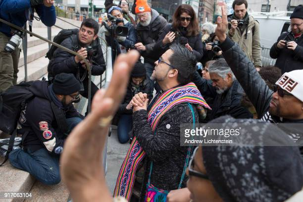 The New Sanctuary Coalition founder Juan Carlos Ruiz leads faith leaders in prayer in front of Federal Plaza to celebrate immigrant activist Ravi...