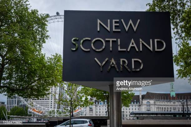 The New Scotland Yard sign and building, the headquarters of the the Metropolitan Police, the police force responsible for policing the boroughs of...