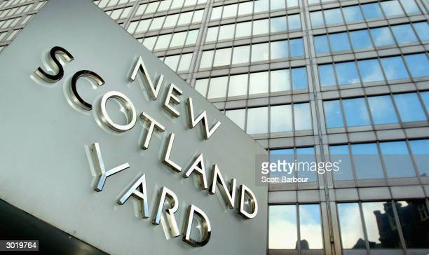 The New Scotland Yard sign spins during the launch of Shop Watch February 27, 2004 in London, England. Shop Watch will see retail shop floor staff...