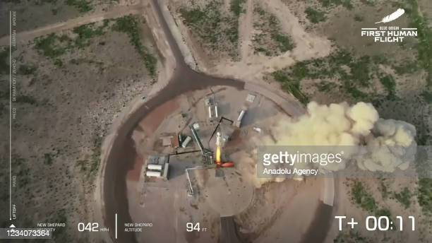 The New Shepard Blue Origin rocket lifts-off from the launch pad carrying Jeff Bezos along with his brother Mark Bezos, 18-year-old Oliver Daemen,...