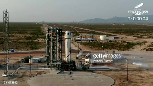 The New Shepard Blue Origin rocket prepares to lift-off from the launch pad carrying Jeff Bezos along with his brother Mark Bezos, 18-year-old Oliver...