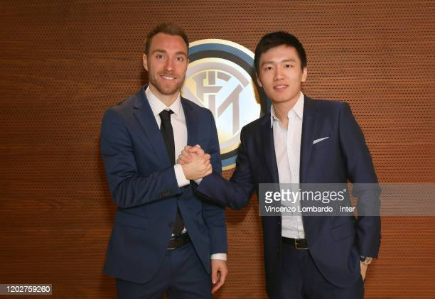 The new signing of FC Internazionale Milano Christian Eriksen shakes hands with FC Internazionale President Steven Zhang on January 28 2020 in Milan...