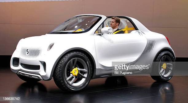 The new Smart For Us vehicle is revealed at the Mercedes-Benz exhibit during a media preview at the 2012 North American International Auto Show...