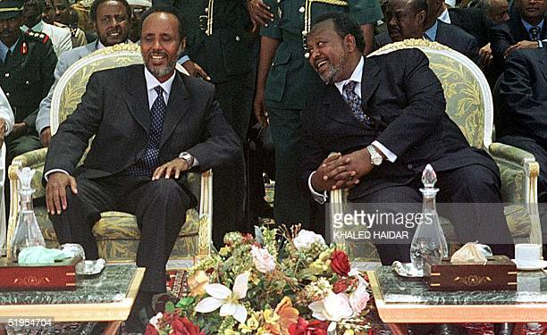The new Somali president Abdulkassim Salat Hassan shares a light moment with his Djibouti counterpart Ismael Omar Guelleh 28 August 2000 in Arta...
