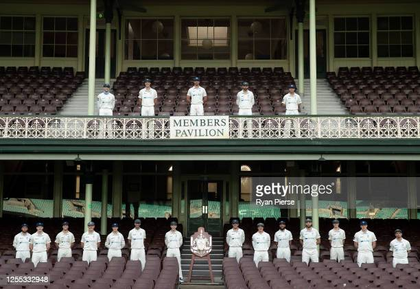 The New South Wales Blues pose practice social distancing as they pose for their Sheffield Shield winning team photo at Sydney Cricket Ground on July...