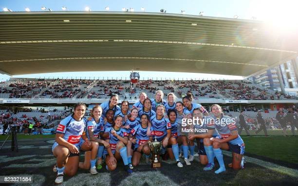 The New South Wales team poses for a photo after winning the Women's Interstate Challenge match between New South Wales and Queensland at WIN Stadium...