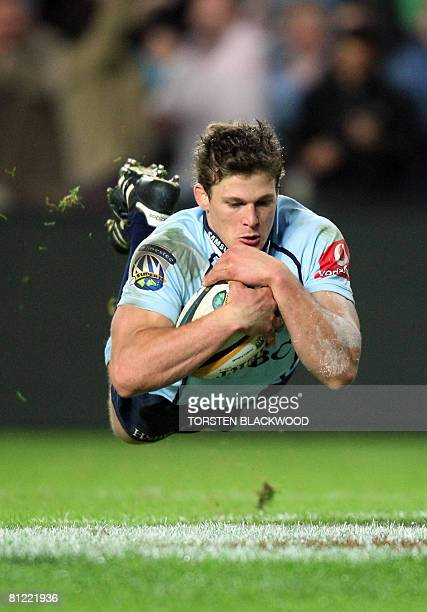 The New South Wales Waratahs' Luke Burgess dives for the Coastal Sharks' try line during the Super 14 rugby semifinal in Sydney on May 24 2008 The...