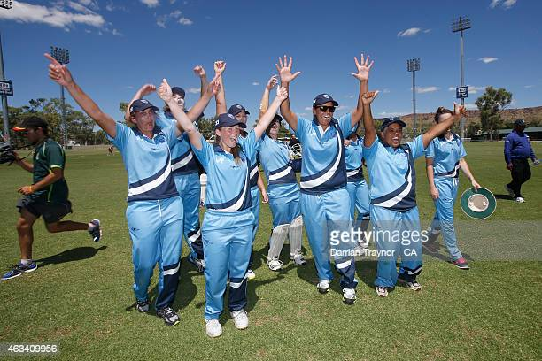 The New South Wales Womens team celebrate their win in the final during the 20415 Imparja Cup on February 14 2015 in Alice Springs Australia