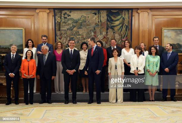 The new spanish government's ministers pose with Spanish Prime Minister Pedro Sanchez and king Felipe VI after taking oath of office at La Zarzuela...