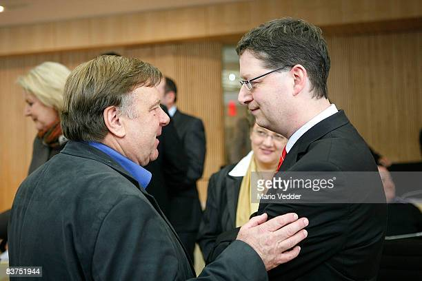 The new SPD candidate for governor in the state of Hesse Thorsten SchaeferGuembel talks to Willi van Ooyen leader of the floor of the German far left...