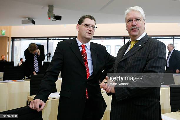 The new SPD candidate for governor in the state of Hesse Thorsten SchaeferGuembel speaks to the leader of the German Liberal Party in the state of...
