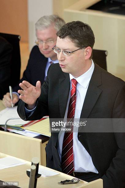 The new SPD candidate for governor in the state of Hesse Thorsten SchaeferGuembel speaks to Roland Koch at the state parliament of Hesse on November...