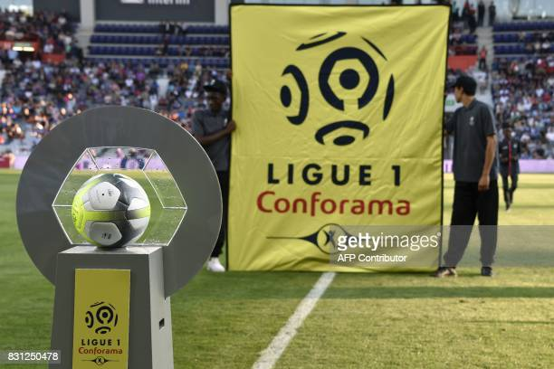 "The new sponsor logo ""Ligue 1 - Conforama"" is installed next to the new official ball, prior to the French Ligue 1 football match between Toulouse..."