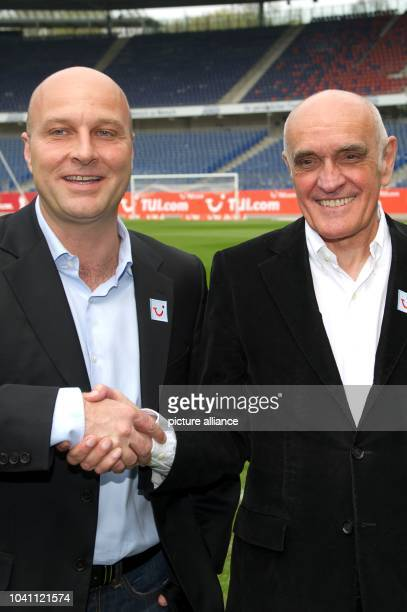 The new sports director of the German Bundesliga soccer club Hannover 96 Dirk Dufner shakes hands with Hannover 96 President Martin Kind at AWDArena...