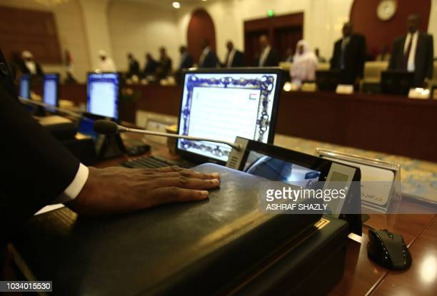 The new Sudanese ministers take the oath of office at the presidential palace in the capital of Khartoum on September 15 2018 Sudan's new 21member...