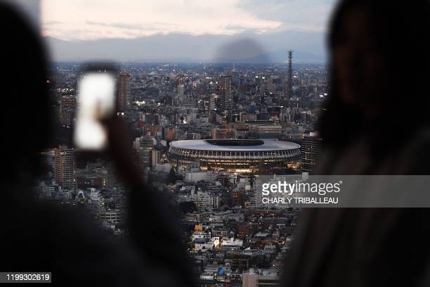 The New Tokyo Stadium, the main venue for the 2020 Tokyo Olympic Games, is seen from a rooftop viewing area in Tokyo on February 8, 2020. - Tokyo...