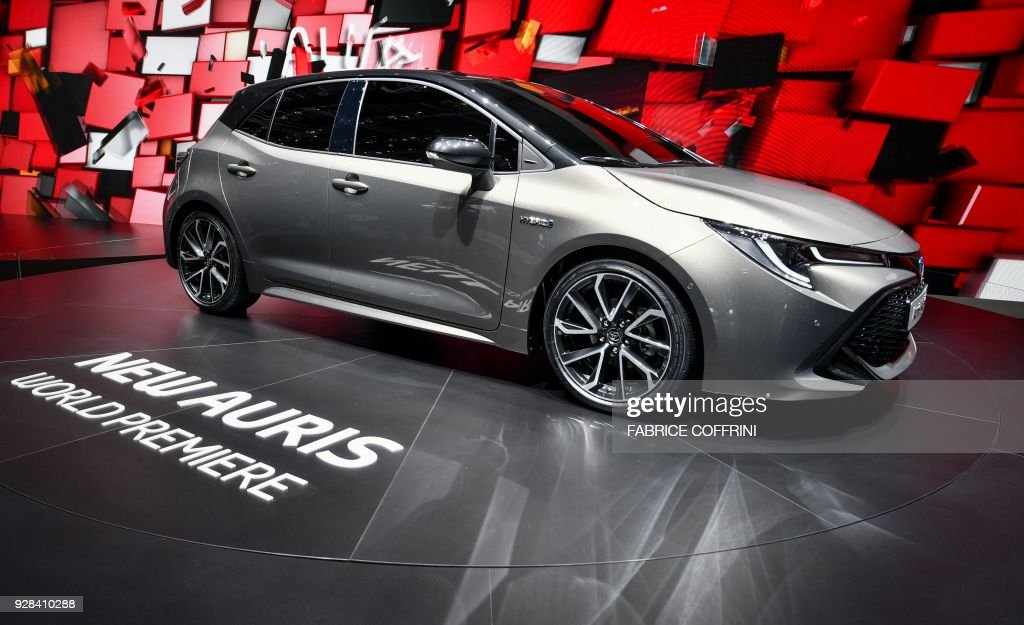 The new Toyota Auris hybrid model car is seen at the stand of Japanese carmaker during the first press day of the Geneva International Motor Show on March 6, 2018 in Geneva. The show opens to the public on March 8 and runs through March 18. / AFP PHOTO / Fabrice COFFRINI
