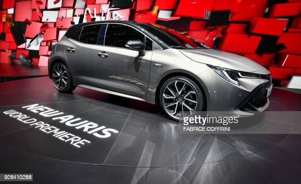 The new Toyota Auris hybrid model car is seen at the stand of Japanese carmaker during the first press day of the Geneva International Motor Show on...