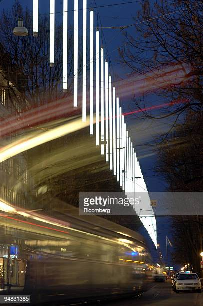 The new tubeshaped Christmas decorations hang above Bahnhofstrasse as a streetcar passes in Zurich Switzerland Tuesday December 13 2005 Zurich's...