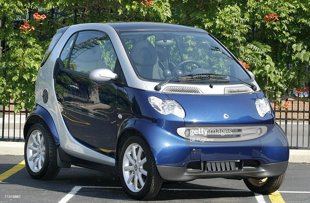 The New Two Seat Smart Car From Daimlerchrysler Sits On Display After At A Press