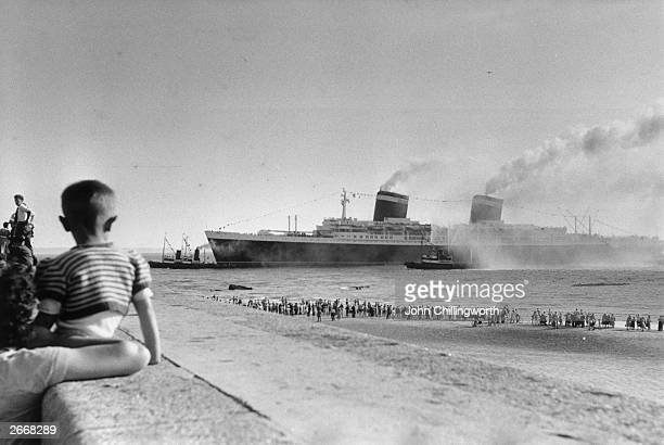 The new United States liner SS United States winner of the Blue Riband for 1952 with a transatlantic crossing speed of 41 mph arrives at Le Havre...
