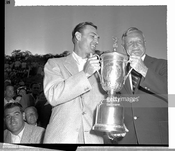The new United States Open Golf Champion, Ben Hogan of Hershey, Pennsylvania , accepts the silver cup of victory from the president of the USGA,...
