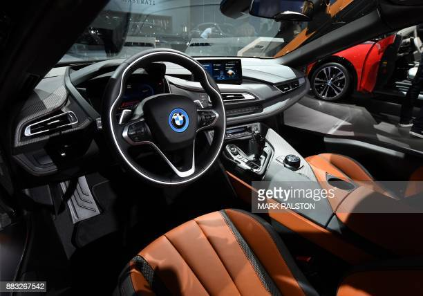 The new updated version of the BMW i8 sports car is on display at the 2017 LA Auto Show in Los Angeles California on November 30 2017 / AFP PHOTO /...