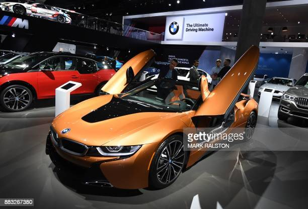 The new updated version of the BMW i8 sports car on display at the 2017 LA Auto Show in Los Angeles California on November 30 2017 / AFP PHOTO / Mark...