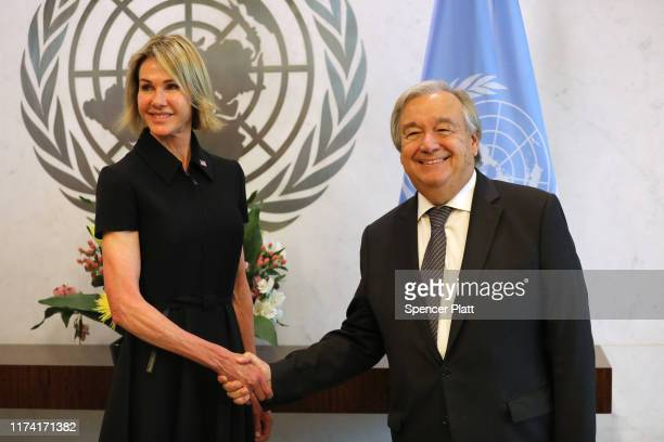 The new US Ambassador to the United Nations Kelly Craft shakes hands with UN Secretary General Antonio Guterres at the UN headquarters on September...