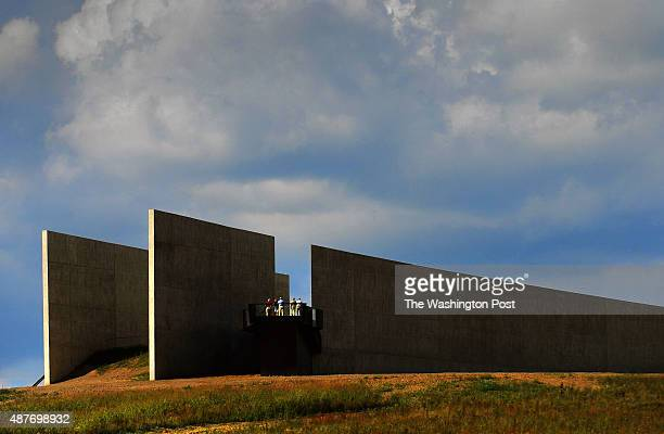 The new visitor center as viewed from the wall of names area of the Flight 93 National Memorial The people on the balcony are family members of those...