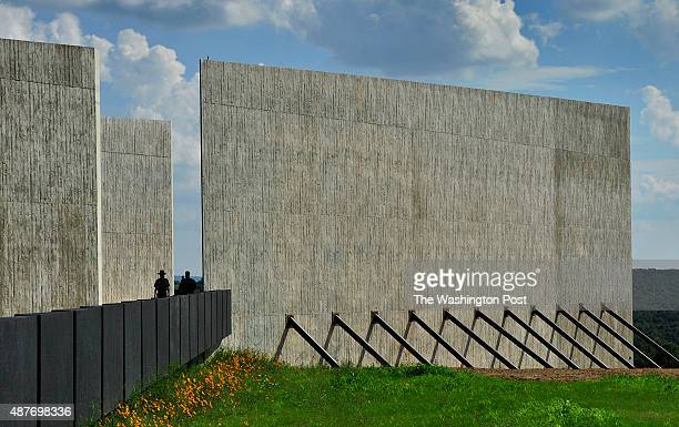 The new visitor center features dramatic concrete walls that follow the path of the doomed Flight 93 Over the edge is the wall of names area and the...