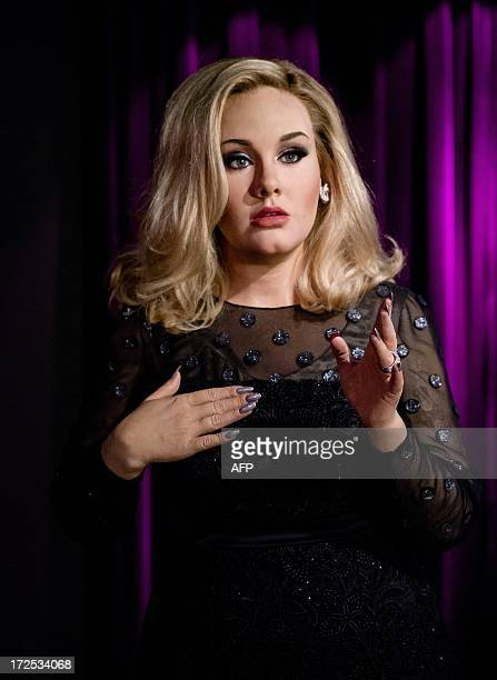 The new wax figure of British singer Adele is presented to the public at Madame Tussauds wax Museum in Amsterdam on July 3 2013 AFP PHOTO / ANP ROBIN...