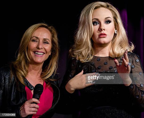 The new wax figure of British singer Adele is presented to the public by Dutch presenter and singer Angela Groothuizen at Madame Tussauds wax Museum...