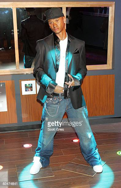 The new wax figure of R B singer Usher on display during a competition to launch the Usher Interactive Experience at Madame Tussauds March 24 2005 in...