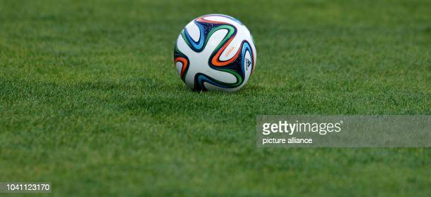 The new World Cup ball Brazuca from Adidas during an FCBayern Munich training session at the stadium'Stade Adrar' in Agadir Morocco 20December...