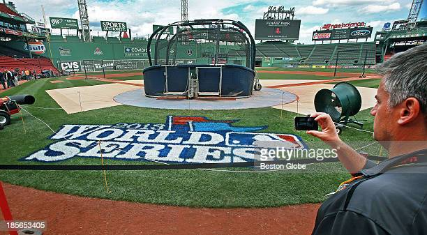 The new World Series logo is in place behind home plate The Boston Red Sox and the St Louis Cardinals worked out at Fenway Park in preparation for...