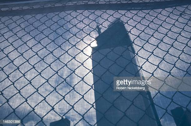 The new World Trade Center buildings under construction stand behind a wire security fence June 6 2012 at Ground Zero in New York City