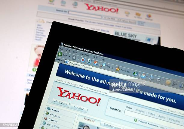 The new Yahoo website homepage is seen on a laptop in front of the older version May 16 2006 in San Francisco California Yahoo launched a newly...