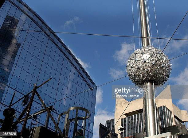 The New Year's Eve Ball travels midway up the 77 foot tall flagpole atop 1 Times Square during the annual test December 30 2003 in New York City The...