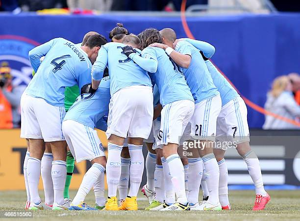 The New York City FC huddle before the start of their inaugural game against the New England Revolution at Yankee Stadium on March 15 2015 in the...
