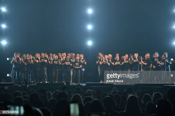 The New York City Gay Men's Chorus performs onstage during the Demi Lovato 'Tell Me You Love Me' World Tour at Barclays Center of Brooklyn on March...