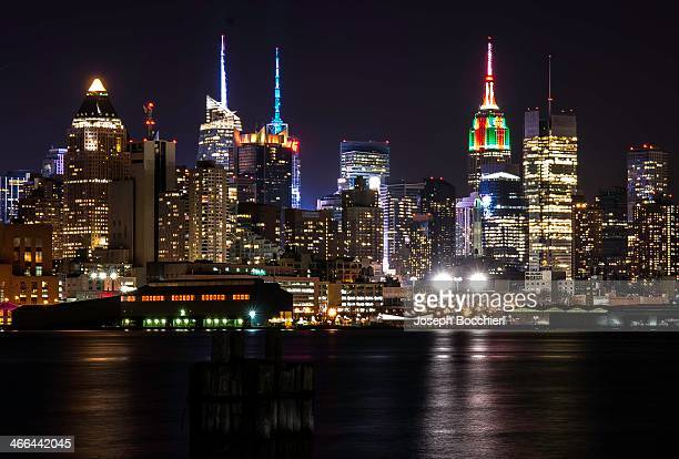 CONTENT] The New York City Skyline during the holiday season The Empire State building wrapped like a present in green and red