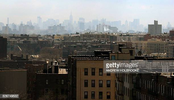 The New York City skyline is viewed through the haze from the Bronx