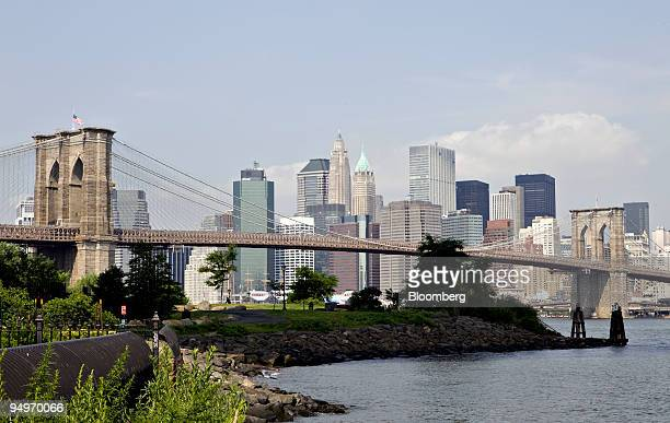 The New York City Skyline stands beyond the Brooklyn Bridge as seen from the Dumbo neighborhood of Brooklyn New York US on Wednesday July 22 2009 New...