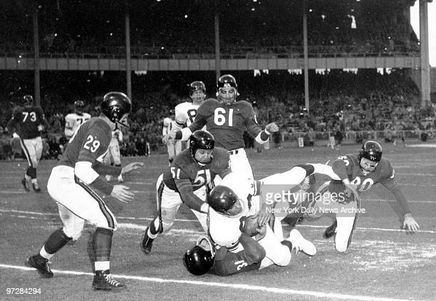 The New York Giants marched to a crushing 477 victory over the Chicago Bears to seize National Football League championship at Yankee Stadium Giants...