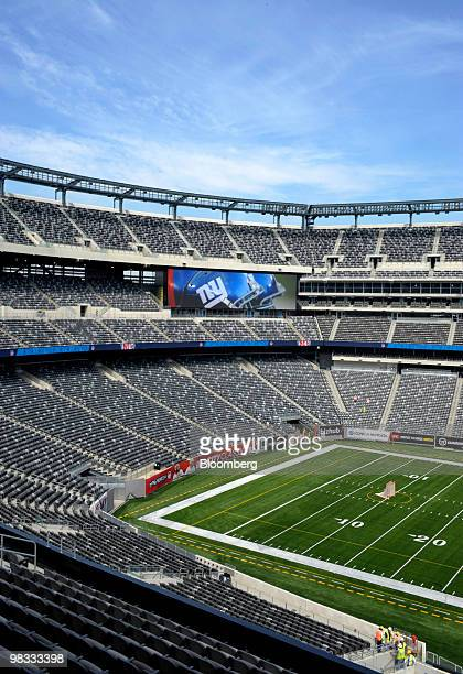The New York Giants team logo is displayed on one of four video screens at the new Meadowlands Stadium in East Rutherford New Jersey US Thursday...